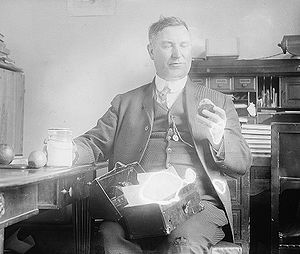 Percy Quin - Percy Quin eating his lunch in his office at the House Office Building in Washington D.C. on March 26, 1920