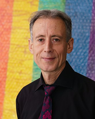 Peter Tatchell - Tatchell with a rainbow flag, the international LGBT symbol