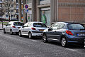 Peugeot, two white 206 and one grey 207.jpg