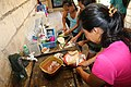 Philippine woman preparing a chicken soup at Bohol.jpg