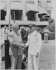 Photograph of President Truman shaking hands with Admiral Marc Mitscher, commander of the 8th Fleet and wartime... - NARA - 199402