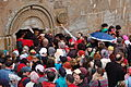 Pilgrims flock to the entrance of the Church of Tsminda Sameba.jpg