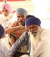 Pilgrims inside the Golden Temple (9693307304).jpg