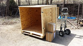 Crate - A plywood sheathed crate with a pallet-like bottom.