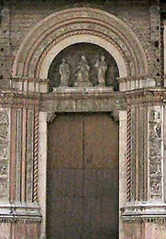 San Petronio Basilica - The Porta Magna with sculpture by Jacopo della Quercia