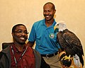 Posing for picture with Bald Eagle. (10594046234).jpg