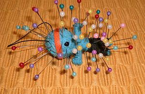 Voodoo doll - Contemporary voodoo doll, with 58 pins