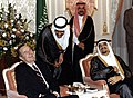 President George H. W. Bush and King Fahd bin Abdulaziz Al Saud share a laugh.jpg