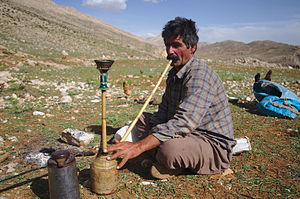Qashqai people - Nomadic Qashqai man with his hookah. Sepidan county, Iran.