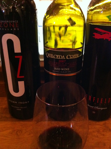 A Glass Of 2007 Quilceda Creek Red Blend From The Columbia Valley AVA Along With Two Other Washington Wines