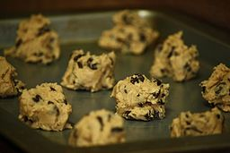 Raw cookie dough in cookie clumps