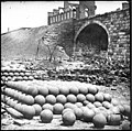 Richmond, Va. Piles of solid shot, canister, etc., in the Arsenal grounds; Richmond & Petersburg Railroad bridge at right LOC cwpb.02741.jpg
