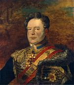 Painting shows a man with a receding hairline and sideburns. He wears a hussar uniform with a red and gold sash over the shoulder.