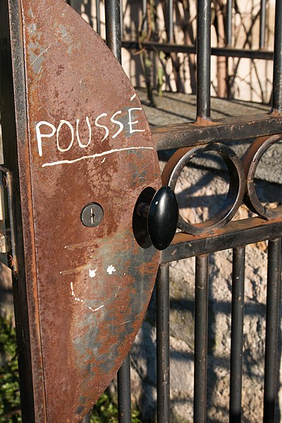 English:  Entrance on the garden of the castle, all piss off!...