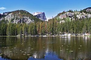 A photograph taken of Nymph Lake in Rocky Moun...