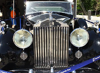 Grille (car) - 1952 Rolls-Royce Phantom IV with the emblematic Parthenon style radiator grille. Top and front surfaces look dead flat but are actually a few thousandths convex, so they will look flat in accordance with design principles learned from the ancient Greeks.