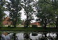 Rzeka Tuga w centrum miasta. W tle Żuławski Ośrodek Kultury i Żuławski Park Historyczny.jpg