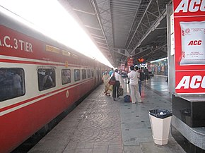 Red-and-white passenger train at the station
