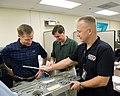 STS-135 crew training Tool-Repair Kits with instructor Jeff Stone.jpg