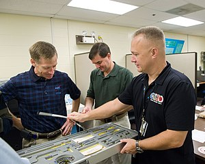 Repair kit - NASA astronauts Chris Ferguson (left), STS-135 commander; Doug Hurley (right), pilot, and Rex Walheim, mission specialist, participate in a tools and repair kits training session in the Space Vehicle Mockup Facility at NASA's Johnson Space Center.