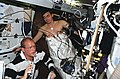 STS-62 Astronauts Gemar and Allen work with lower body negative pressure experiment.jpg