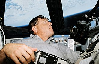 Michael A. Baker - Baker looking at the Earth during STS-68.