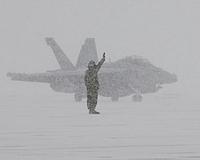 Sailor directs an EA-18G during snow storm in Japan (8367035559).jpg