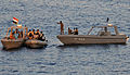 Sailors from USS Halsey assist in bringing a Yemen patrol boat alongside Halsey..jpg