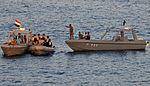 Sailors from USS Halsey assist in bringing a Yemen patrol boat alongside Halsey..jpg