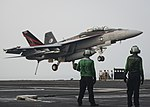 Sailors watch as an F-A-18F Super prepares to land aboard USS Nimitz in the Arabian Gulf. (36617121231).jpg