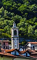 Sala Comacina church tower and wooded mountainside from Lake Como ferry.jpg