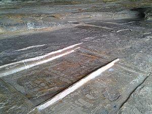 Sittanavasal - Stone beds or Ezhadippattam with inscriptions of Jain saints