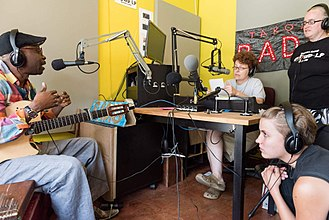 Interview - A musician interviewed in a radio studio