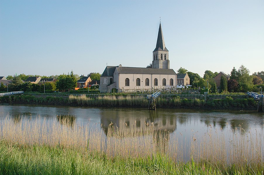 Schellebelle's main church - the Sint-Jan Onthoofdingkerk - as seen from across the Scheldt on a June evening.