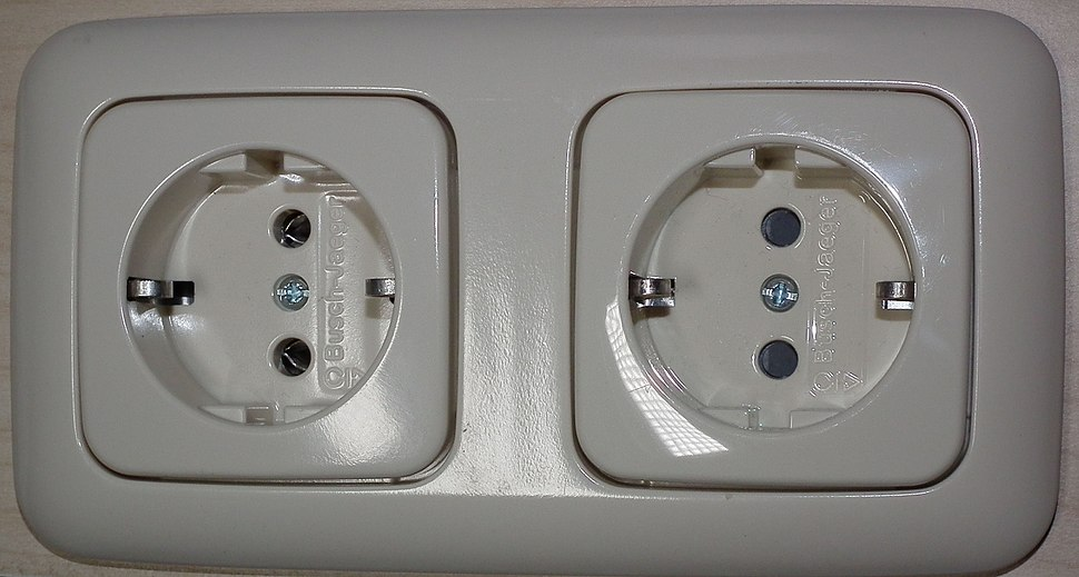 Schuko socket-outlets manufactured by Busch-Jaeger Elektro GmbH, RH socket has protective shutters, LH does not