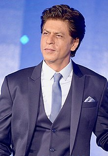 Shahrukh Khan is seen looking away from the camera