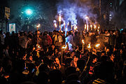 Protesters at night, with torches