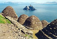 view over Skellig Michael showing stone beehive structures and Small Skellig island in the distance