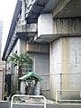 Small shrine on Tokaido Shinkansen under viaduct in Yokohama.jpg