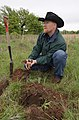 Soil scientist Nathan Haile examines soil health in well managed rangeland. (25085480346).jpg