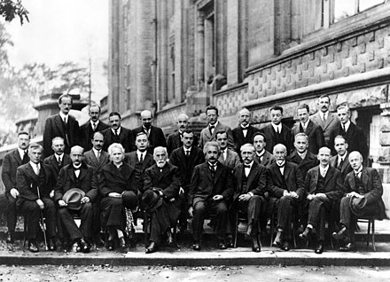 Solvay Conference of 1927, with prominent physicists such as Albert Einstein, Werner Heisenberg, Max Planck, Hendrik Lorentz, Niels Bohr, Marie Curie, Erwin Schrodinger and Paul Dirac Solvay conference 1927.jpg