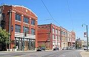Three-story red brick buildings