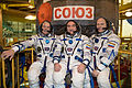 Soyuz TMA-12M crew in front of their spacecraft.jpg