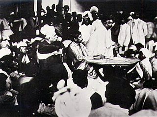 Sri Aurobindo presiding over a meeting of the Nationalists after the Surat Congress, with Tilak speaking, 1907.jpg