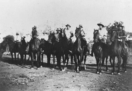 Riders gather for a dingo drive in Morven, Queensland, 1936 StateLibQld 1 140043 Riders gather for a dingo drive at Durella Station in Morven, ca. 1936.jpg