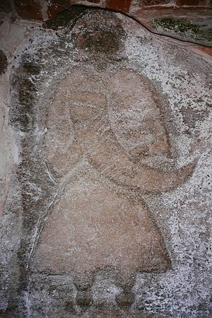 Pomerania during the Early Middle Ages - A priest of Svantevit depicted on a stone from Arkona, now in the church of Altenkirchen.