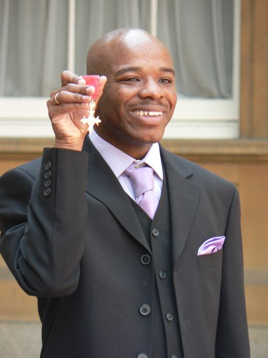 Stephen Wiltshire holding MBE