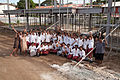 Students from Caritas Technical Secondary School outside the structure of the new boarding school funded by AusAID, East Boroko, PNG. (10726037096).jpg