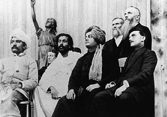 (left) Vivekananda on the platform at the Parliament of Religions, September 1893; left to right: Virchand Gandhi, Dharmapala, Vivekananda