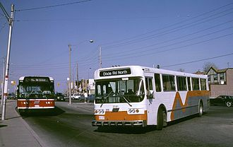 MiWay - A Mississauga Flyer D800 bus (type now retired) meeting a TTC bus at Long Branch Loop in 1987.